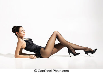 Beautiful, slim lady wearing provocative pantyhose over...