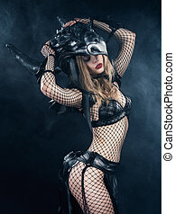 Beautiful slim sexy young blond woman dressed in masquerade...