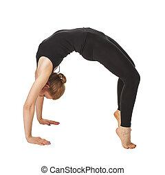 Beautiful slim woman doing yoga. Isolated on white...