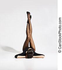 Beautiful, slim woman posing in alluring underwear and...