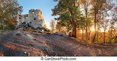 Beautiful Slovakia landscape at autumn with Uhrovec castle ruins at sunset
