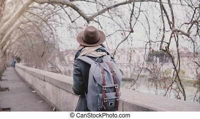 Beautiful slow motion shot of local girl with backpack...