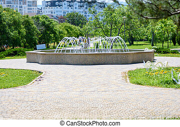 """Beautiful small fountain in the city park """"Nut Grove"""" in Anapa, Russia"""