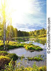 Beautiful small river and splendid sunrise in russia