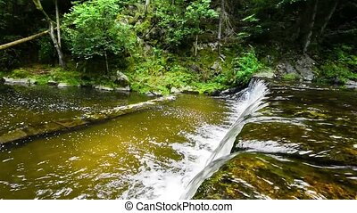 Beautiful small waterfall in forest stream in South Czech....