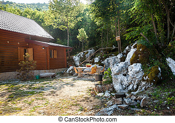 small wooden house in forest on high mountain