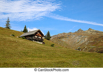 Beautiful small wooden house on a mountainside.