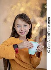 Cute girl in orange shirt smiling nicely