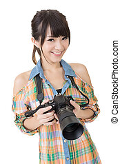 Beautiful smiling asian woman with photo camera