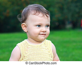Beautiful smiling baby girl on nature summer. Closeup portrait