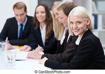 Beautiful smiling blond business woman