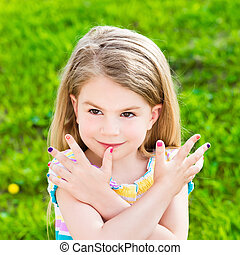 Beautiful smiling blond little girl with long hair