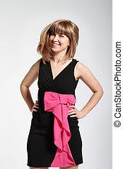 Beautiful smiling blonde girl in black dress
