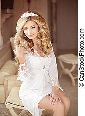 Beautiful smiling bride girl with makeup long wavy hair