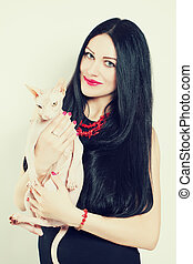 Beautiful Smiling Brunette Girl and her Cat