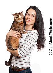 beautiful smiling brunette girl and her ginger cat over...
