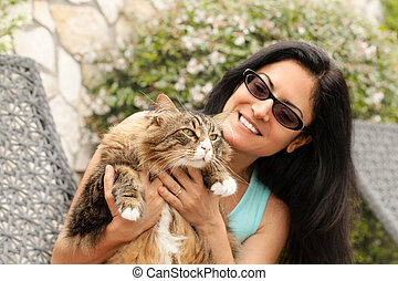 Beautiful smiling brunette Woman With Maine Coon Cat