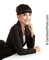Beautiful smiling businesswoman looking at camera