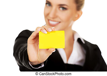 Beautiful smiling businesswoman with business card