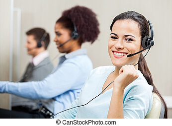Beautiful Smiling Customer Service Representative In Office