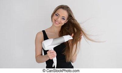 Beautiful smiling girl drying her