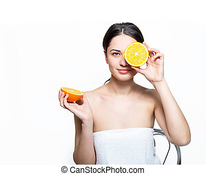 beautiful smiling girl holding an orange