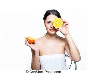 beautiful smiling girl holding an orange