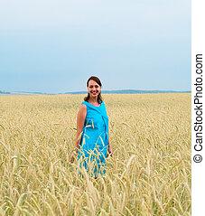 smiling girl in blue dress