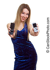 smiling girl in blue dress with two cellular phones