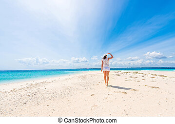 beautiful smiling girl in hat on a beach