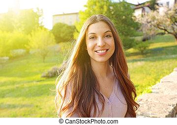 Beautiful smiling girl outdoor portrait
