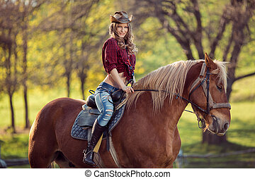 Beautiful smiling girl riding horse on autumn field - Young...