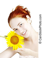 Beautiful smiling girl with a sunflower in the hands