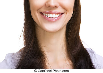 Beautiful smiling girl with retainer for teeth isolated
