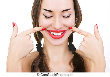 Beautiful smiling girl with retainer for teeth, and with red lipstick