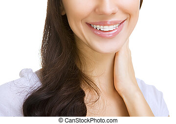 Beautiful smiling girl with retainer for teeth