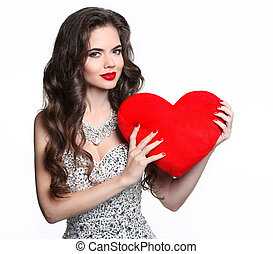 Beautiful smiling girl with valentine heart