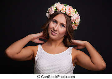 Beautiful smiling girl with wreath