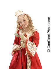 Beautiful smiling little girl in princess costume standing with rose
