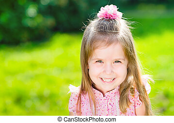 Beautiful smiling little girl with long blond hair