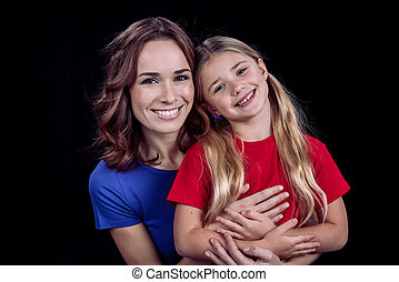 Beautiful smiling mother and daughter