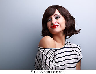 Beautiful smiling short hair woman looking happy on blue background