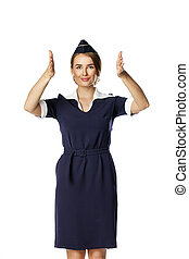 Beautiful smiling stewardess isolated on a white background