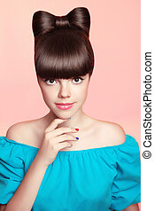 Beautiful smiling teen girl with bow hairstyle, makeup and...