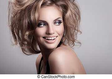 Beautiful smiling woman. Cosmetics and hairstyle.