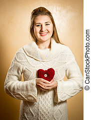 smiling woman holding big red knitted heart - Beautiful...