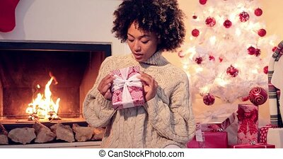Beautiful smiling woman holding xmas boxed gift