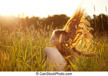 Beautiful smiling woman in a field