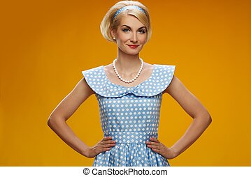 Beautiful smiling woman in blue dress