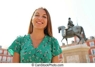 Beautiful smiling woman in Plaza Mayor square, Madrid, Spain